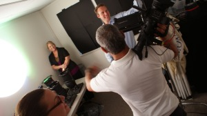 Debra Hiebert with Tres Fabu Event Planning and Matt Brys with Extreme Productions prepare for another shot