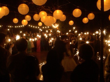 A first dance with flair with all guests watching on with sparklers and smiles :)
